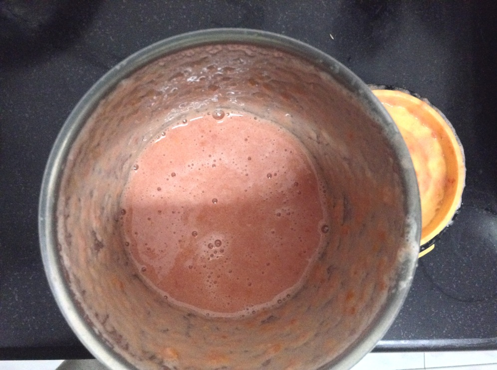 Grind the tomatoes into a smooth paste in a grinder.