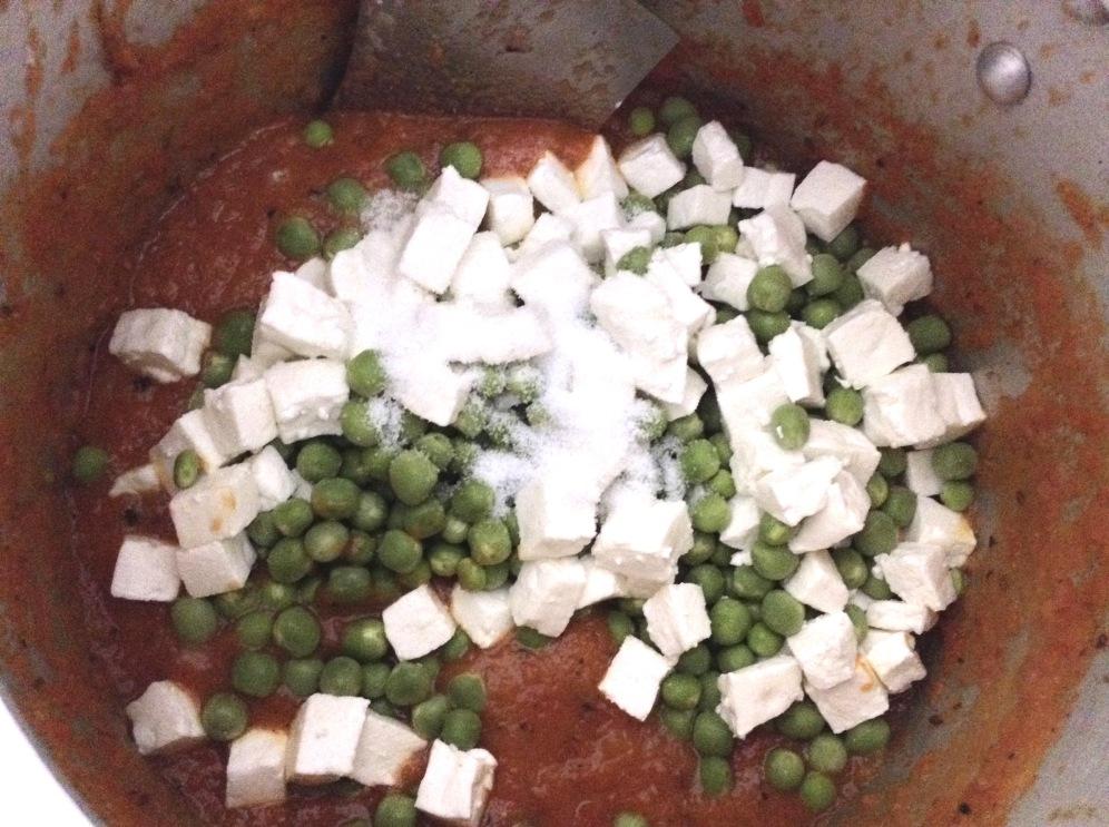 Add the paneer, peas and salt now.